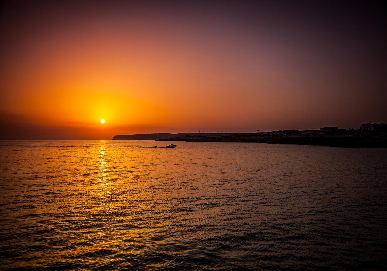 spiaggia Lampedusa tramonto foto archivio mysunsea
